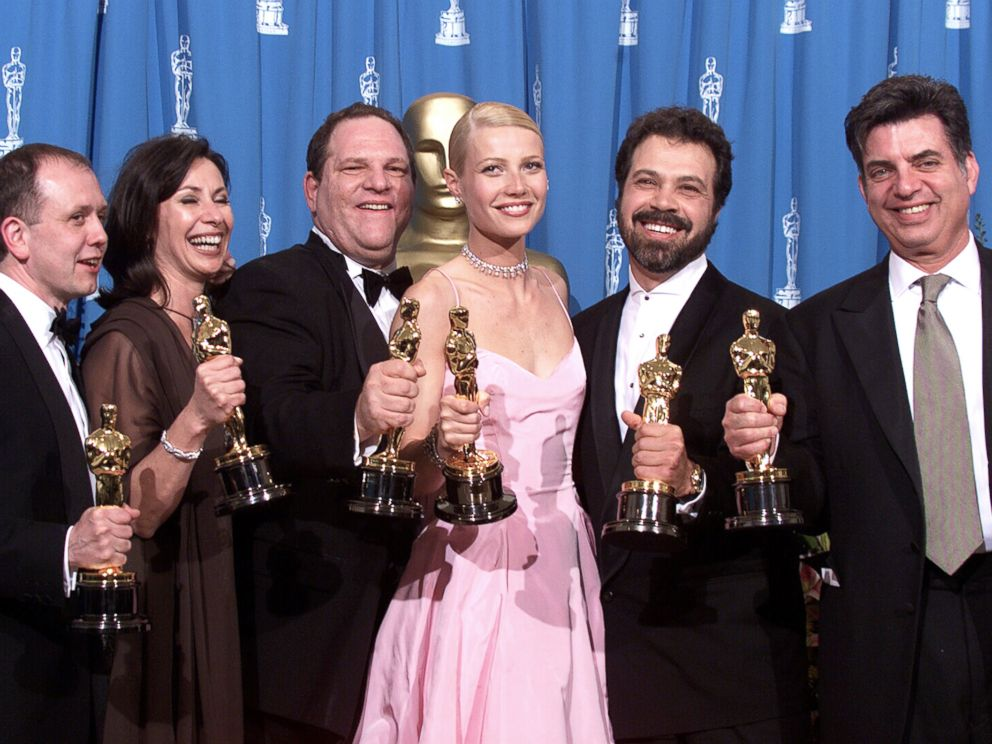 PHOTO: Shakespeare in Love Best Actress winner Gwyneth Paltrow (center) is joined by Harvey Weinstein (center left) and other stars as they celebrated their win of Best Picture at the 1999 Academy Awards in Hollywood, Calif., on March 21, 1999.