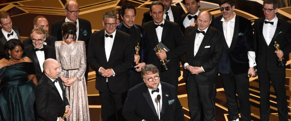 "PHOTO: Guillermo del Toro and the cast and crew of ""The Shape of Water"" accept the award for best picture at the Oscars, March 4, 2018, at the Dolby Theatre in Los Angeles."