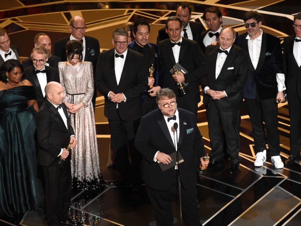 PHOTO: Guillermo del Toro and the cast and crew of The Shape of Water accept the award for best picture at the Oscars, March 4, 2018, at the Dolby Theatre in Los Angeles.