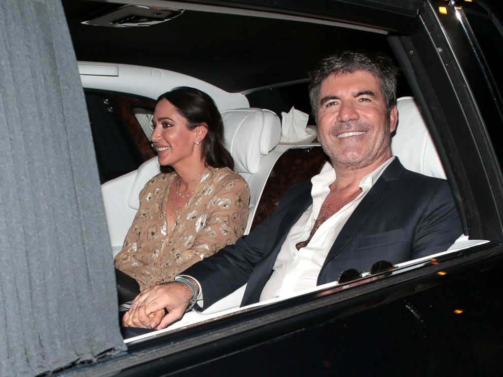 PHOTO: Lauren Silverman and Simon Cowell seen leaving Hammersmith Apollo after Britains Got Talent - semi final day 3, May 30, 2018 in London, England.