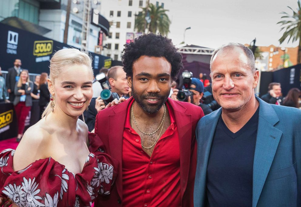PHOTO: From left, Emilia Clarke, Donald Glover and Woody Harrelson arrive at the Solo: A Star Wars Story film premiere, May 10, 2018, in Los Angeles.