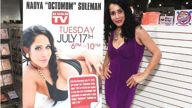 PHOTO: Nadya Suleman, better known as Octomom, signs copies of her first adult DVD at the Castle Megastore in Phoenix.