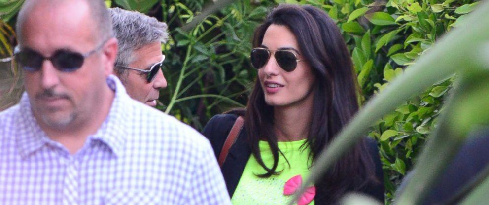 PHOTO: George Clooney and Amal Alamuddin leaving Cafe Habana Malibu on May 11, 2014.