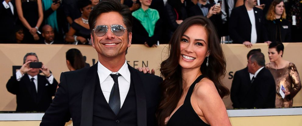 PHOTO: John Stamos, left, and Caitlin McHugh arrive at the 24th annual Screen Actors Guild Awards at the Shrine Auditorium & Expo Hall in Los Angeles in this Jan. 21, 2018 file photo.