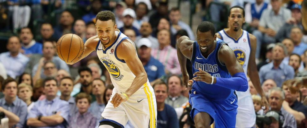 PHOTO: Golden State Warriors guard Stephen Curry and Mavericks Harrison Barnes during the first half of an NBA basketball game in, Dallas, Oct. 23, 2017.