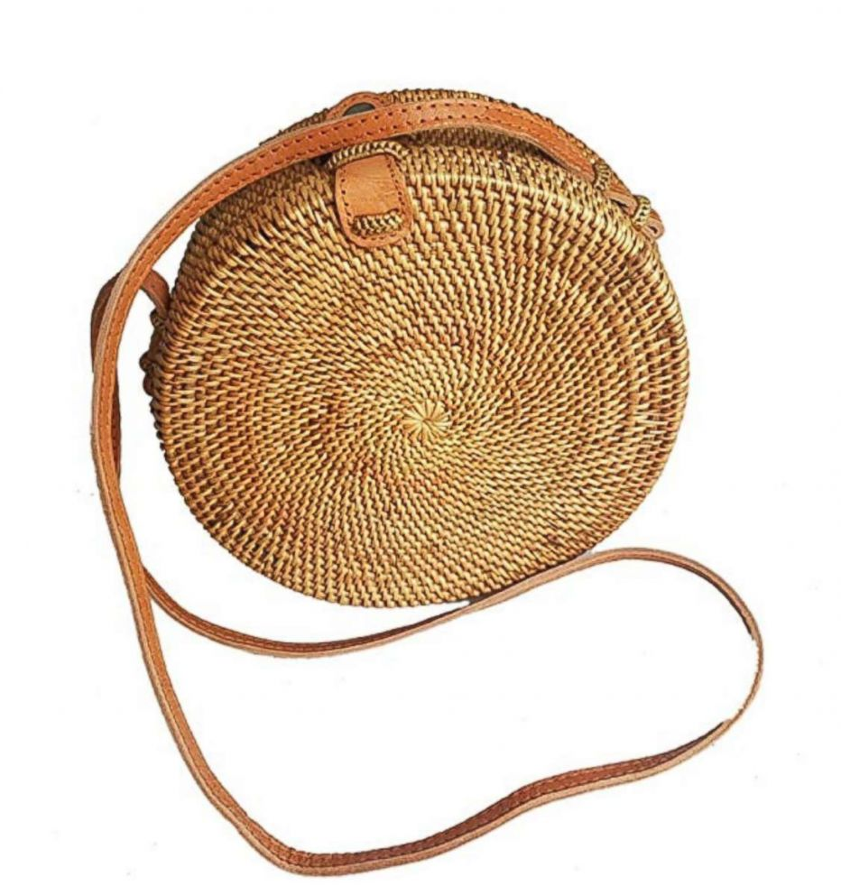 PHOTO: This year's summer bag is the sleek and compact round crossbody, in straw.