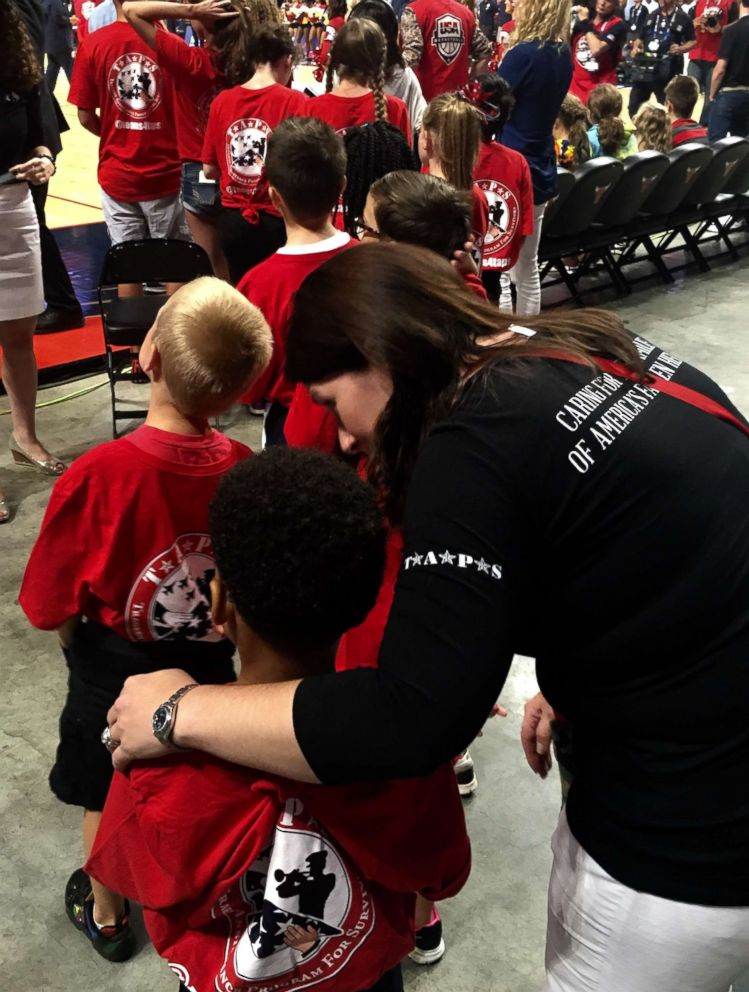PHOTO: Diana Roday Hosford is seen here with a TAPS child at an NBA All-Star game in an undated handout photo.