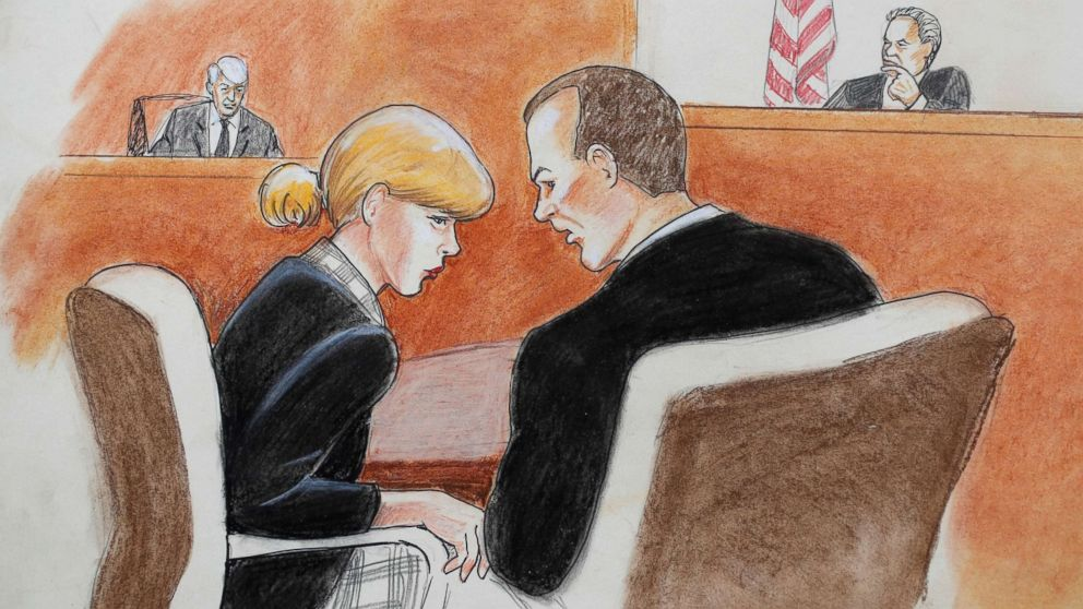 Singer Taylor Swift confers with her attorney during a civil trial in federal court, Aug. 8, 2017, in Denver.