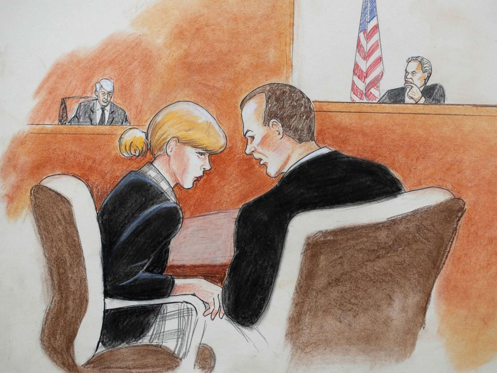 PHOTO: Singer Taylor Swift confers with her attorney during a civil trial in federal court, Aug. 8, 2017, in Denver.