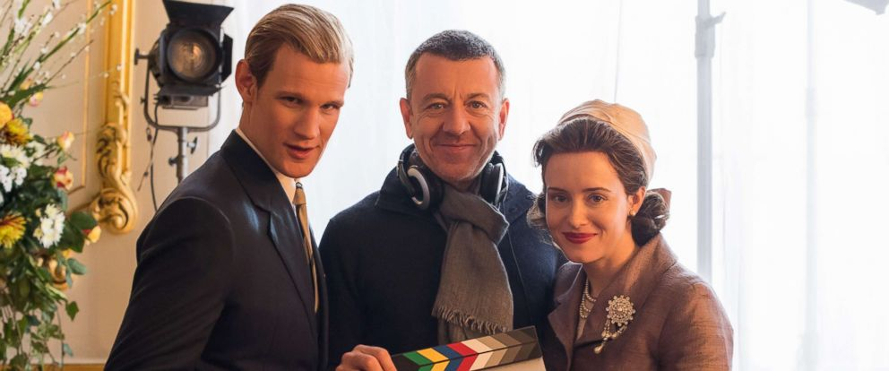 """PHOTO: Matt Smith and Claire Foy pose for a photo with the creator of """"The Crown,"""" Peter Morgan."""