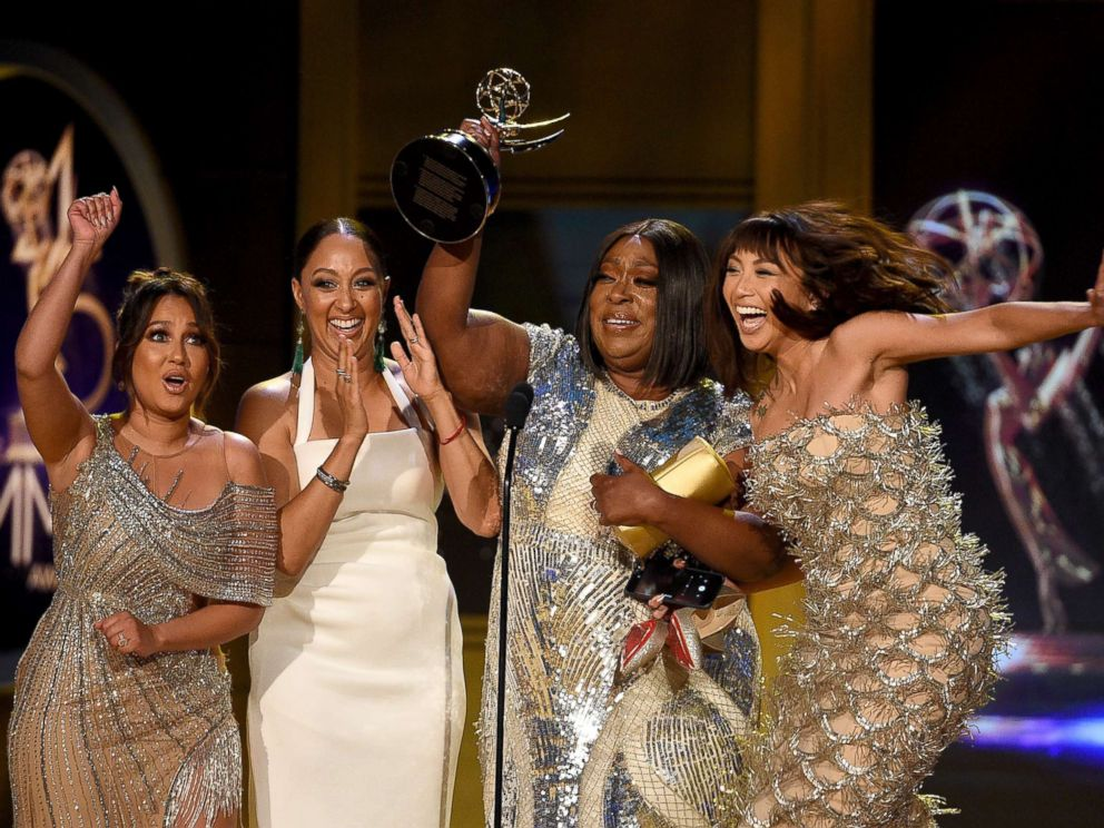 PHOTO: Adrienne Bailon, Tamera Mowry, Loni Love and Jeannie Mai, winners of Outstanding Entertainment Talk Show Host for The Real, onstage during the 45th annual Daytime Emmy Awards on April 29, 2018 in Pasadena, Calif.