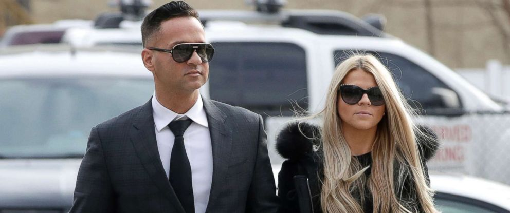 "Michael ""The Situation"" Sorrentino, left, one of the former stars of the ""Jersey Shore"" reality TV show walks with his fiancee Lauren Pesce while arriving at the Martin Luther King, Jr., Federal Courthouse for a hearing, Jan. 19, 2018, in Newark, N.J."