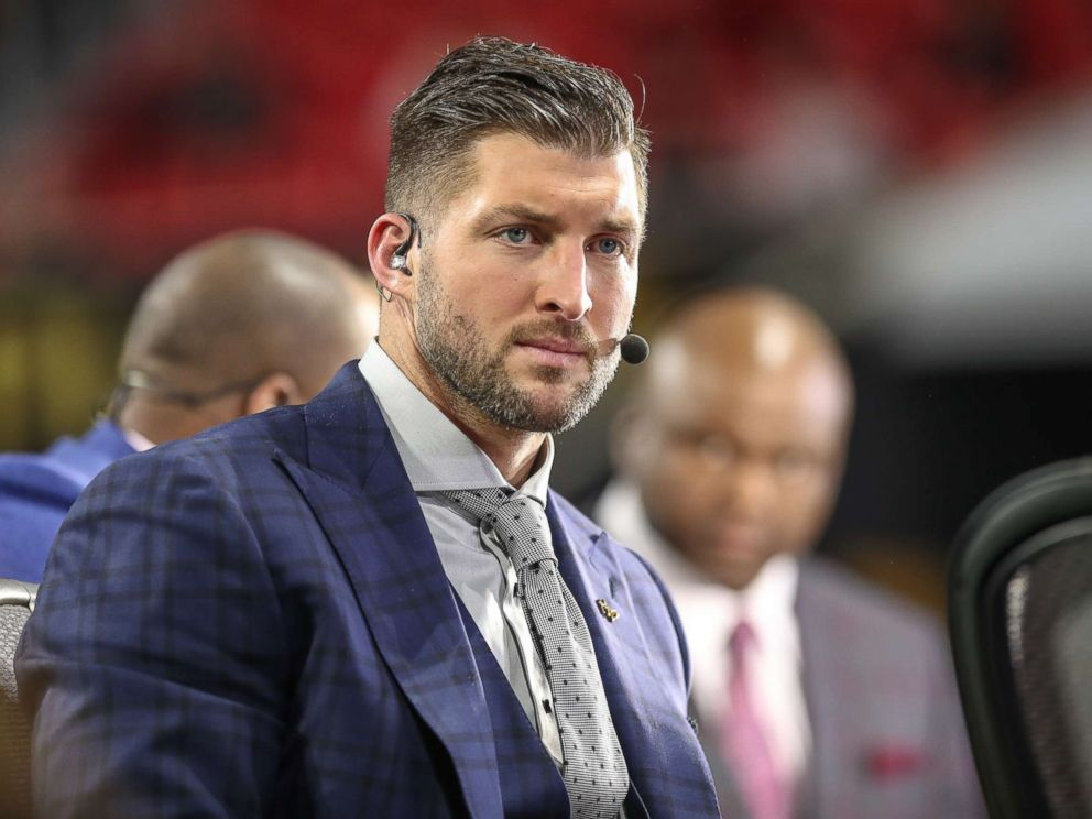 PHOTO: Tim Tebow looks on before the College Football Playoff National Championship Game between the Alabama Crimson Tide and the Georgia Bulldogs on January 8, 2018 at Mercedes-Benz Stadium in Atlanta, GA.