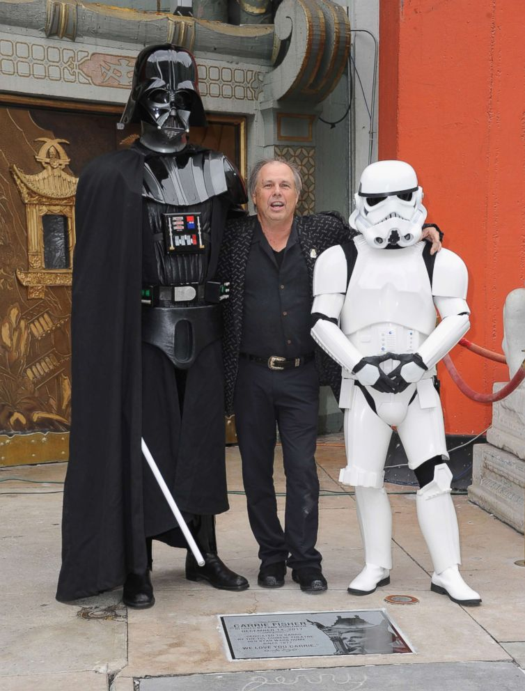 PHOTO: Todd Fisher, Darth Vader and a Storm Trooper pose beside the etched granite plaque for the late Carrie Fisher in front of the TCL Chinese Theater on May 24, 2018 in Hollywood, Calif.