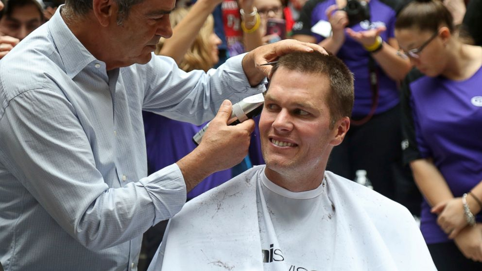 "New England Patriots quarterback Tom Brady gets his head shaved by Pini Swissa at the ""Saving By Shaving"" event in support of the Dana-Farber Cancer Institute at Granite Telecommunications in Quincy, Mass., March 8, 2018."