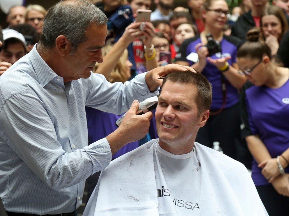 PHOTO: New England Patriots quarterback Tom Brady gets his head shaved by Pini Swissa at the Saving By Shaving event in support of the Dana-Farber Cancer Institute at Granite Telecommunications in Quincy, Mass., March 8, 2018.