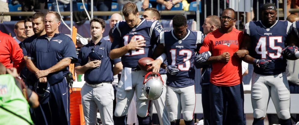 New England Patriots head coach Bill Belichick, left, and Tom Brady, Phillip Dorsett, Matthew Slater, second from right, and David Harris, stand during the national anthem before a game against the Houston Texans, Sept. 24, 2017, in Foxborough, Mass.