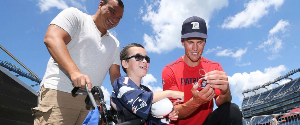 PHOTO: Tom Brady visits with children during Make-A-Wish event at Gillette Stadium, July 26, 2017, in Foxborough, Mass.