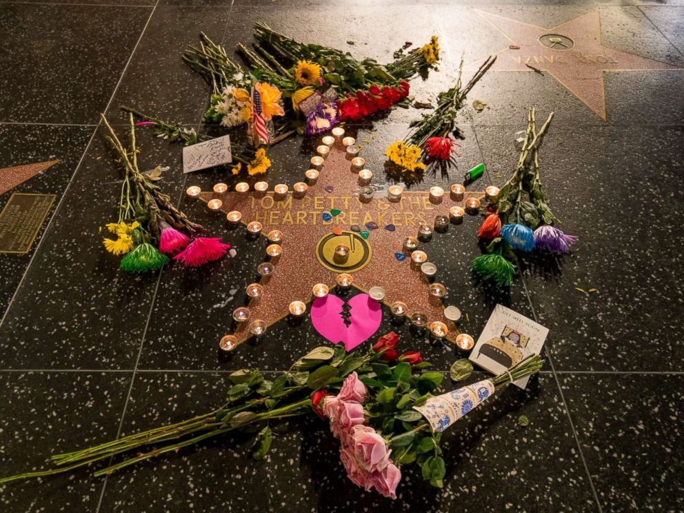 PHOTO: Fans leave flowers on Tom Pettys star on the Hollywood Walk of Fame after the announcement of his death, Oct. 2, 2017, in Los Angeles.