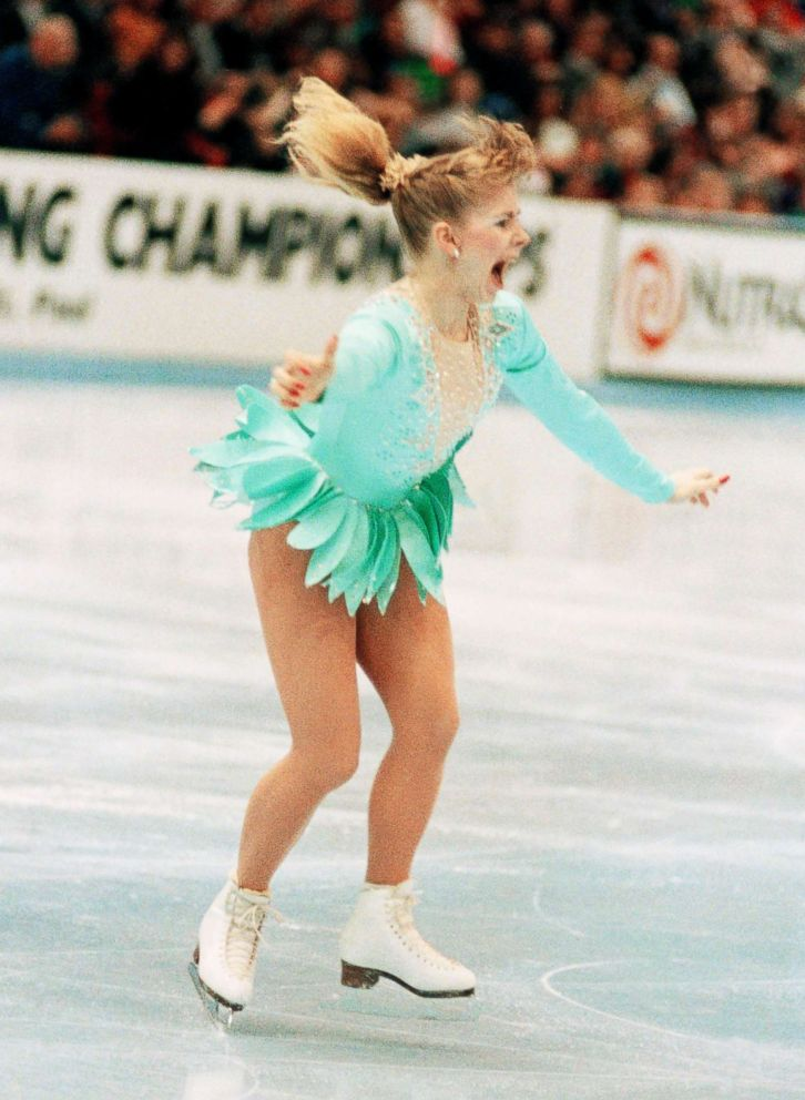 A jubilant Tonya Harding is acknowledged by the crowd as she comes out of her successful triple axel on her way to winning the U.S. Figure Skating Championships on Feb. 16, 1991, in Minneapolis.