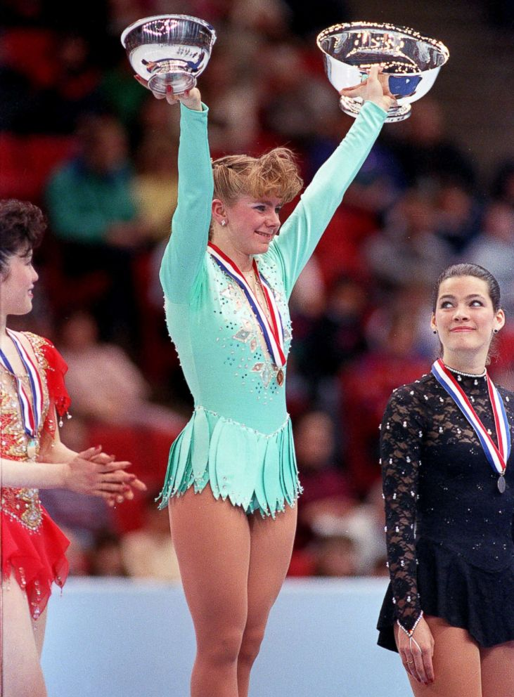 Tonya Harding of Portland, Ore., raises her trophies after winning the U.S. Figure Skating Championship in Minneapolis, Feb. 16, 1991. At left is Kristi Yamaguchi, with third place Nancy Kerrigan at right.