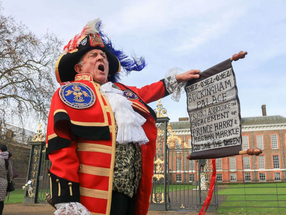 PHOTO: A town crier outside Kensington Palace announces the Royal engagement of Prince Harry to Meghan Markle, Nov. 27, 2017, in London.