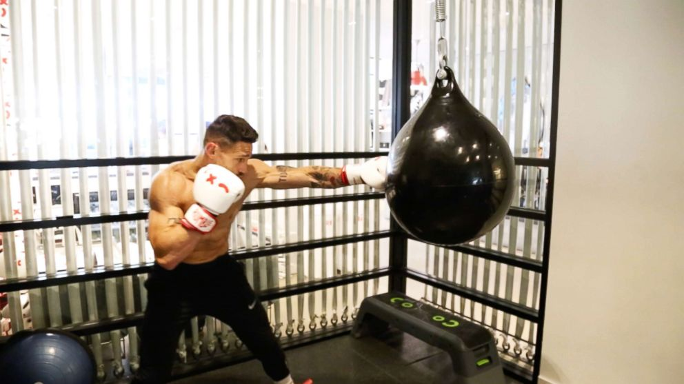 PHOTO: Noah Neiman demonstrates a boxing move at New York Citys Rumble Boxing Studio.