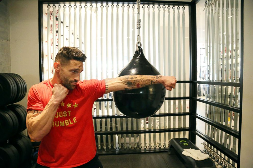 PHOTO: Noah Neiman demonstrates a move at New York Citys Rumble Boxing Studio.
