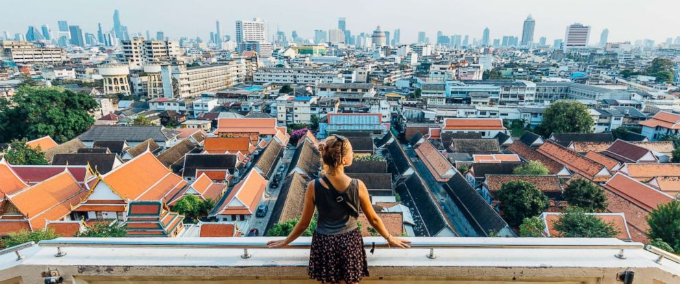 PHOTO: A tourist looks out over a city in this undated stock image.