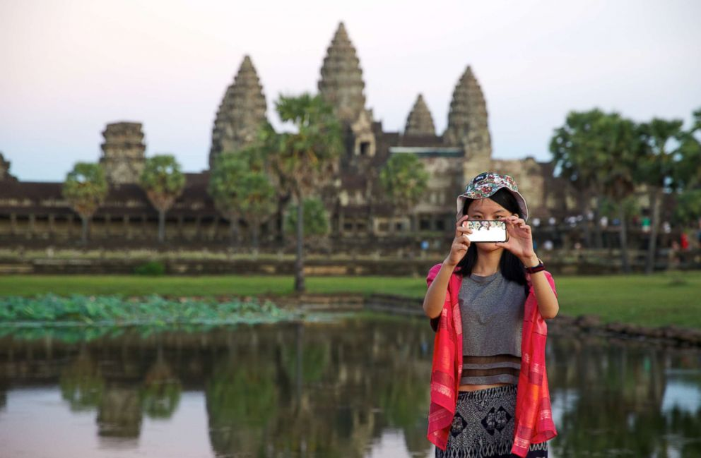 PHOTO: A visitor takes a selfie at Angkor Wat, Cambodia.