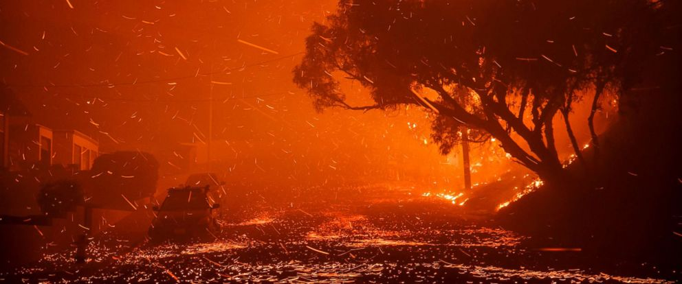 PHOTO: A brush fire moving with the wind sends embers all over the place in residential neighborhoods north of Ventura, destroying homes and forcing 27,000 people to evacuate.