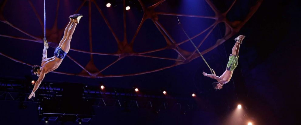 """PHOTO: Yann Arnaud and GoelOuisse perform at the """"Cirque Du Soleils Totem"""" Dress Rehearsal at Citi Field, March 13, 2013 in New York City."""