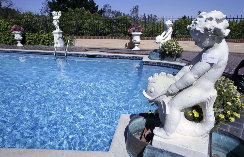 PHOTO: Cast stone figural fountain with four-part copper jardinieres belonging to the late Hungarian-American actress Zsa Zsa Gabor around the pool at the actress residence in Bel Air, Calif., April 12, 2018.