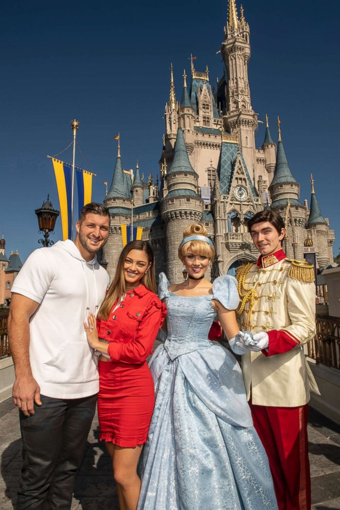 Professional athlete and sports analyst Tim Tebow and fiancee Demi-Leigh Nel-Peters strike a pose with Cinderella and Prince Charming at Magic Kingdom Park at Walt Disney World Resort in Lake Buena Vista, Fla., Friday, Jan. 11, 2019, while celebrating their recent engagement with family and friends. (Kent Phillips, photographer)
