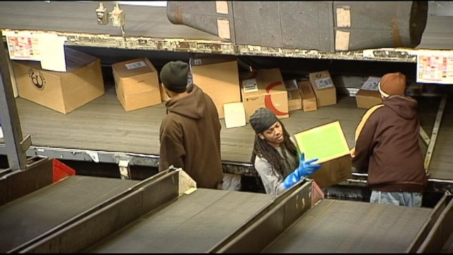 """VIDEO: Officials blame """"perfect storm"""" of bad weather, surprisingly high volume for delayed shipments."""