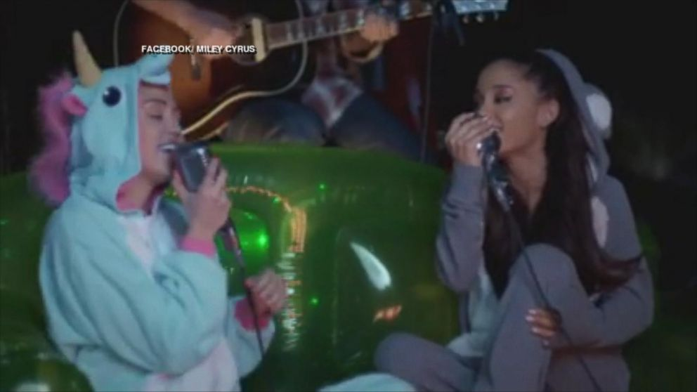 Miley Cyrus And Ariana Grande Cover Don T Dream It S Over In Onesies Abc News