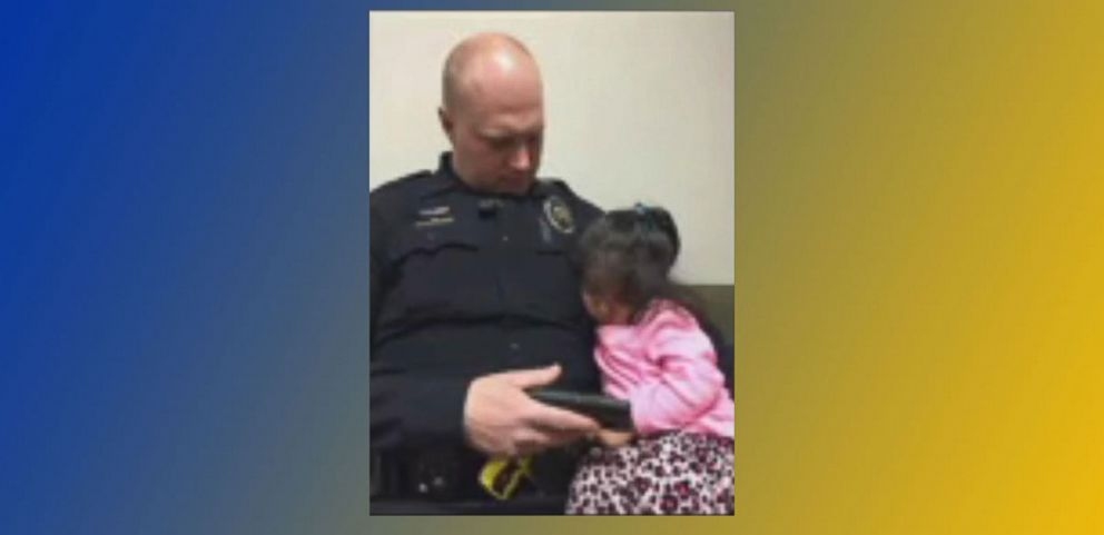 VIDEO: Officer Captured Tending to Toddler Waiting for Her Father in Court