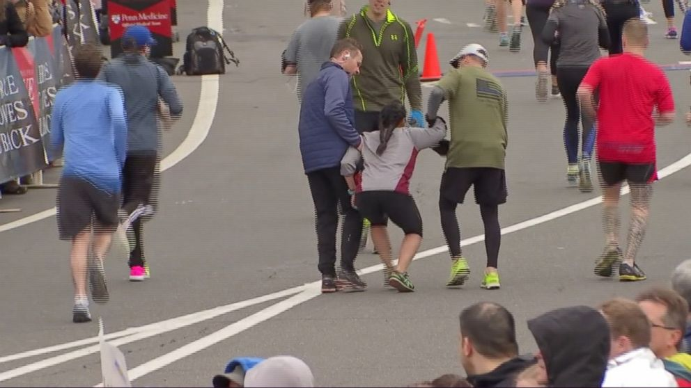 Half Marathon Runner Carries Fatigued Woman To Finish Line Video