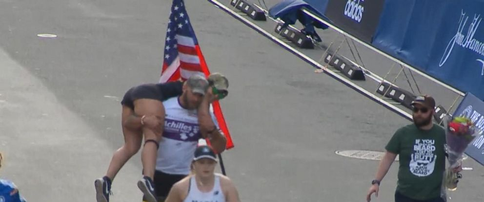 VIDEO: Veteran who lost leg in Afghanistan carries woman across Boston Marathon finish line
