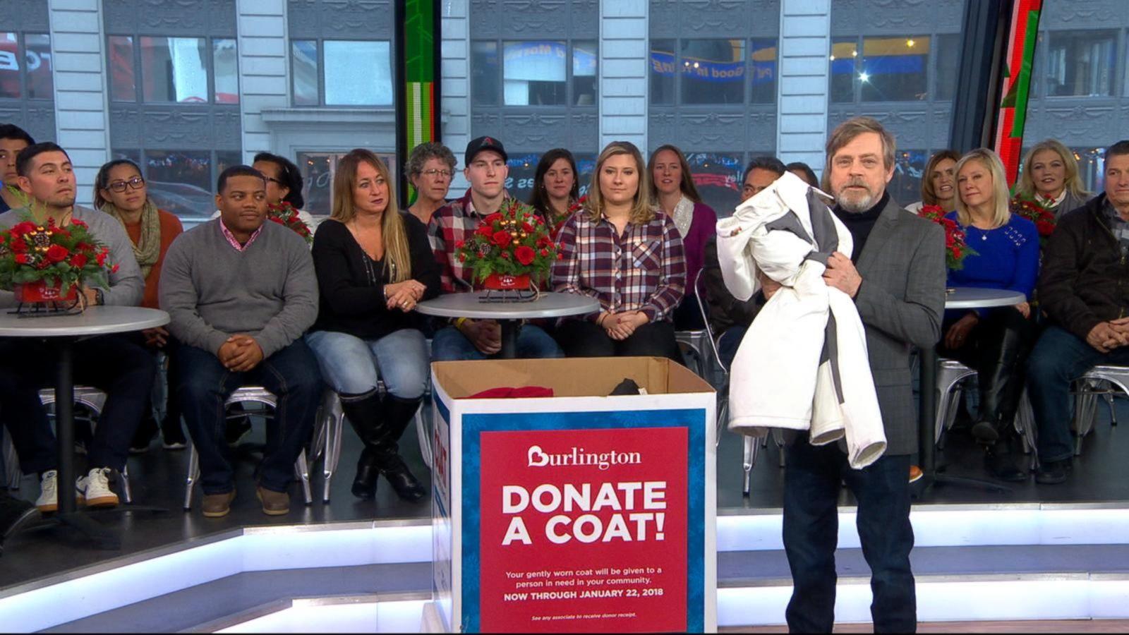 Mark Hamill donates a coat to the Burlington Coat Drive