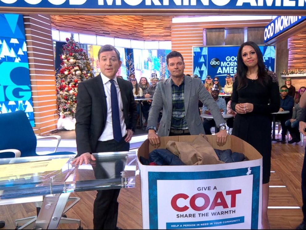 Ryan Seacrest donates a coat to the Burlington Coat Drive live on 'GMA'