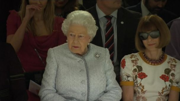d4dab655dd1 Queen Elizabeth II sits next to Anna Wintour at London Fashion Week show.  British royalty rubbed shoulders ...