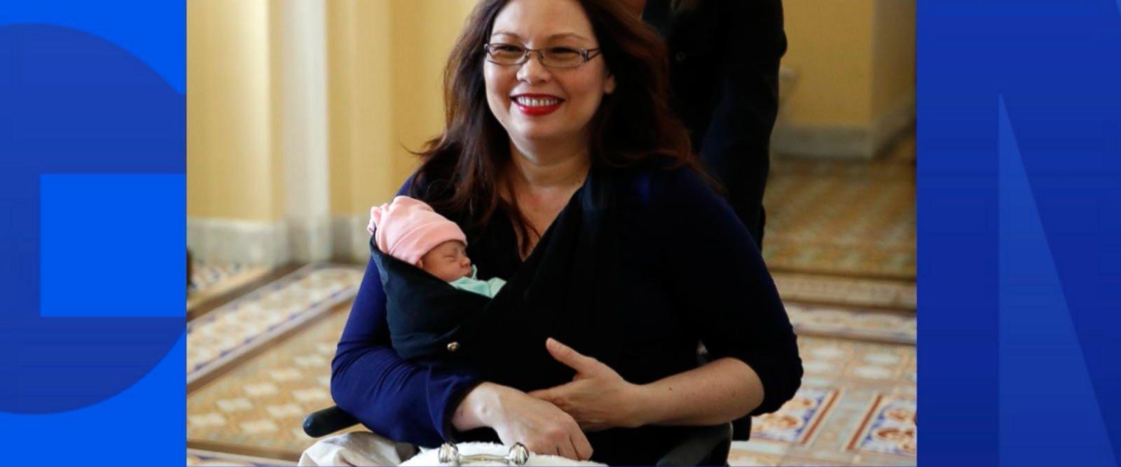 VIDEO: US Senator casts vote holding newborn