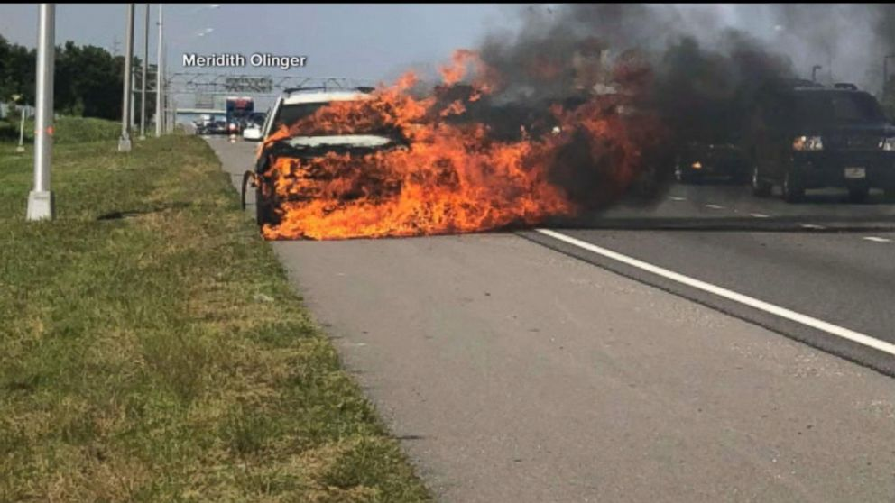 Hero saves highway driver from car on fire
