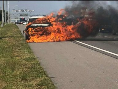WATCH: Hero saves highway driver from car on fire