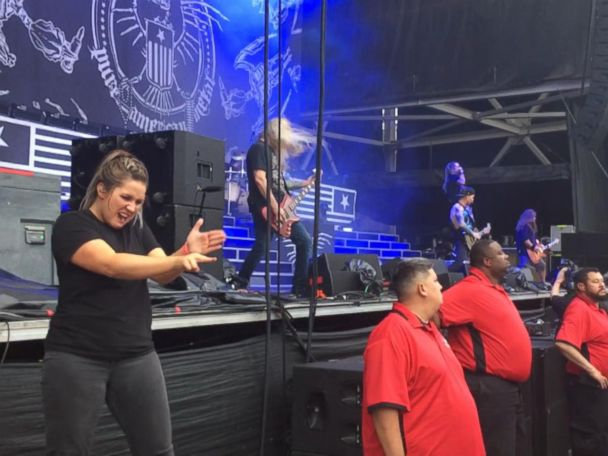 WATCH:  Sign language interpreter rocks out at heavy metal concert