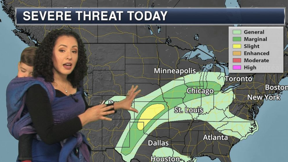 Mom meteorologist wears her 1-year-old to work while reporting weather forecast