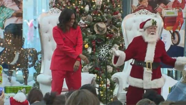 Michelle Obama dances in surprise visit with Santa