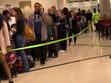 WATCH:  TSA wait times spike as absence rate soars