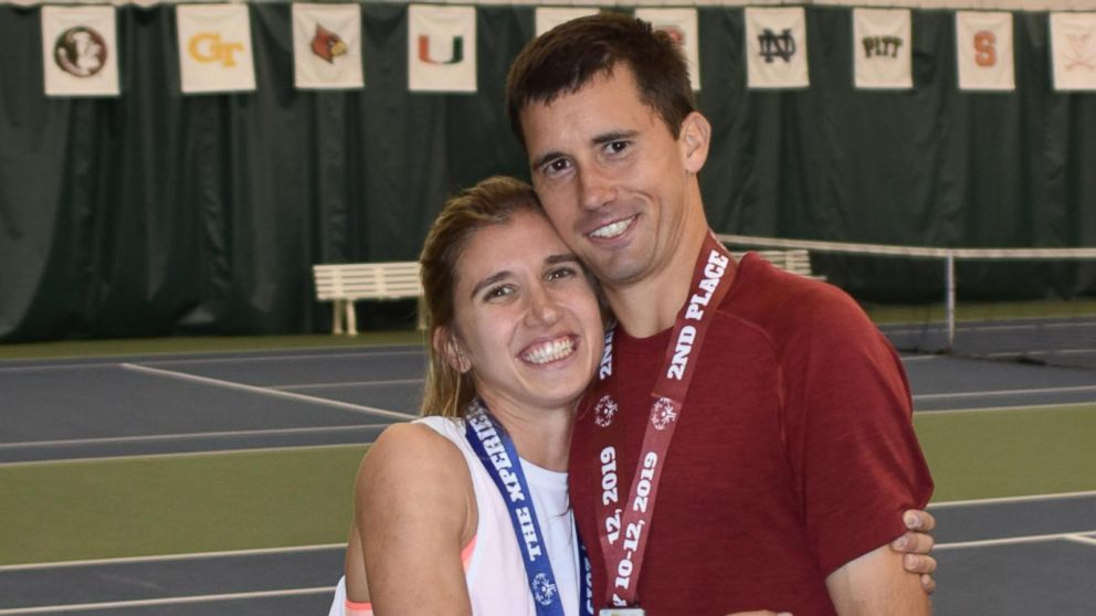 Engaged Special Olympics tennis partners support each other on and off the court